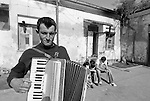 Romanians are good workers and good musicians. Like this guy who tries to earn some money playing his accordion. They arrive from the most depressed and flood damaged regions of Romania. As new EU citizens they expect to be welcome to Italy. They are frced in abandoned industrial areas, until police come to turn them away. romanian squatters in an abandoned factory in Italy, moving from a place to another becouse of police