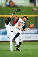 Quad Cities River Bandits left fielder Pat Porter (31) and shortstop Kristian Trompiz (3) collide on a shallow fly ball during a game against the Bowling Green Hot Rods on July 24, 2016 at Modern Woodmen Park in Davenport, Iowa.  Quad Cities defeated Bowling Green 6-5.  (Mike Janes/Four Seam Images)