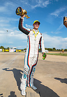 Oct 7, 2018; Ennis, TX, USA; NHRA pro stock driver Tanner Gray celebrates after winning the Fall Nationals at the Texas Motorplex. Mandatory Credit: Mark J. Rebilas-USA TODAY Sports