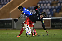 Josh Key of Exeter City and Michael Folivi of Colchester United during Colchester United vs Exeter City, Sky Bet EFL League 2 Football at the JobServe Community Stadium on 23rd February 2021