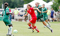 Cat Whitehill #4 goes pass  Christie Welsh..Saint Louis Athletica were defeated 1-0 by Washington Freedom at Anheuser-Busch, Soccer Park, Fenton, Missouri.