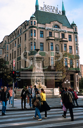 Belgrade, Serbia. The Art Nouveau Hotel Moscow (Moskva) built in 1906 by architect Jovan Ilkić with pedestrians on a pedestrian crossing.