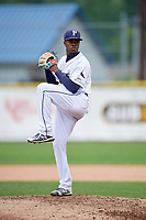 Princeton Rays starting pitcher Joe Peguero (18) delivers a pitch during the first game of a doubleheader against the Greeneville Reds on July 25, 2018 at Hunnicutt Field in Princeton, West Virginia.  Princeton defeated Greeneville 6-4.  (Mike Janes/Four Seam Images)