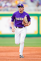 Center fielder Mikie Mahtook #8 of the LSU Tigers jogs off the field between innings against the Wake Forest Demon Deacons at Alex Box Stadium on February 20, 2011 in Baton Rouge, Louisiana.  The Tigers defeated the Demon Deacons 9-1.  Photo by Brian Westerholt / Four Seam Images