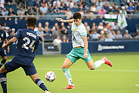 KANSAS CITY, KS - AUGUST 10: Santiago Colombatto #22 Club Leon shoots on goal during a game between Club Leon and Sporting Kansas City at Children's Mercy Park on August 10, 2021 in Kansas City, Kansas.