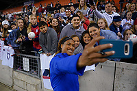 HOUSTON, TX - JANUARY 31: Jessica McDonald #14 fans of the United States celebrate with selfies during a game between Panama and USWNT at BBVA Stadium on January 31, 2020 in Houston, Texas.