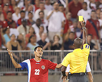 Yellow Card: Costa Rican forward Jairo Arrieta (22) from Courtney Campbell. In CONCACAF Gold Cup Group Stage, the U.S. Men's National Team (USMNT) (blue/white) defeated Costa Rica (red/blue), 1-0, at Rentschler Field, East Hartford, CT on July 16, 2013.
