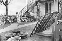 Village de Saint-Jean-Vianney, dans les jours suivant le glissement de terrain du 4 mai 1971<br /> <br /> <br /> Sitting amid his possessions waiting for a vehicle to come and move them out of his home in the Quebec dormitory village of St. Jean Vianney; Dollard Halvey; district engineer with the Quebec department of natural resources; rests his head wearily on his hand. Many of the 1;300 village residents have been moving out; fearful of further landslides like the one destroyed 42 homes Tuesday.<br /> <br /> PHOTO :  Jeff Goode - Toronto Star Archives - AQP