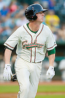 Colin Moran (14) of the Greensboro Grasshoppers hustles down the first base line against the Charleston RiverDogs at NewBridge Bank Park on July 17, 2013 in Greensboro, North Carolina.  The Grasshoppers defeated the RiverDogs 4-3.  (Brian Westerholt/Four Seam Images)