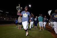 Osleivis Basabe (9) of the Charleston RiverDogs runs around the bases holding the Low-A East Championship trophy following their win over the Down East Wood Ducks at Joseph P. Riley, Jr. Park on September 26, 2021 in Charleston, South Carolina. (Brian Westerholt/Four Seam Images)