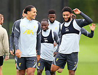 14th September 2021: The  AXA Training Centre, Kirkby, Knowsley, Merseyside, England: Liverpool FC training ahead of Champions League game versus AC Milan on 15th September: Virgil van Dijk of Liverpool shares a joke with team mate Joe Gomez of Liverpool