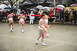 February  20th, 2016, Inazawa, Japan - Participant of Naked Man festival is carrying sake packs on Saturday, February  20, 2016.<br /> Sake helps participants to stay warm during cold weather. The festival organised by Konomiya Shrine, takes place annually on the 13th of the lunar calendar. It is one of the oldest festivals in Japan. Since the old days, the participants are men only, mostly of the ages 24, 42 and 61, which are considered unlucky in Japan. By taking part in the festival they are hoping to avoid the bad luck throughout the coming year.