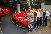 Lesa France Kennedy, chief executive officer of International Speedway Corporation and vice chairperson of the board of directors of NASCAR, with Toyota executives Ed Laukes and David Wilson, and Toyota Racing drivers Kyle Busch and Christopher Bell with Tetsuya Tada, chief engineer of the new Supra