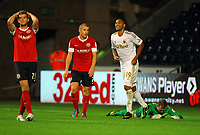 Pictured: Luke Moore of Swansea (3rd L) celebrating his goal, goalkeeper Ben Alnwick (R) and other Barnsley players look dejected. Tuesday 28 August 2012<br /> Re: Capital One Cup game, Swansea City FC v Barnsley at the Liberty Stadium, south Wales.