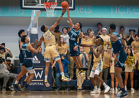 WASHINGTON, DC - FEBRUARY 8: Fatts Russell #1 of Rhode Island and Ace Stallings #20 of George Washington challenge under the basket during a game between Rhode Island and George Washington at Charles E Smith Center on February 8, 2020 in Washington, DC.