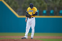UNCG Spartans relief pitcher Phillip Sanderson (9) checks his wristband for the pitch call during the game against the San Diego State Aztecs at Springs Brooks Stadium on February 16, 2020 in Conway, South Carolina. The Spartans defeated the Aztecs 11-4.  (Brian Westerholt/Four Seam Images)