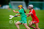 A determined Aoife Behan of Kerry stayed ahead of Corks Tara McCarthy  in the Munster Junior Camogie semi final.