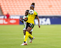 HOUSTON, TX - JUNE 10: Toni Payne #9 of Nigeria collides with Allyson Swaby #17 of Jamaica during a game between Nigeria and Jamaica at BBVA Stadium on June 10, 2021 in Houston, Texas.