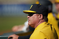 Missouri Tigers pitching coach Fred Corral watches from the dugout during the game against the Oklahoma Sooners in game four of the 2020 Shriners Hospitals for Children College Classic at Minute Maid Park on February 29, 2020 in Houston, Texas. The Tigers defeated the Sooners 8-7. (Brian Westerholt/Four Seam Images)