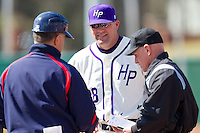 High Point Panthers head coach Craig Cozart #38 exchanges lineup cards with Dayton Flyers head coach Tony Vittorio and home plate umpire Randy Collins prior to the start of the game at Willard Stadium on February 26, 2012 in High Point, North Carolina.    (Brian Westerholt / Four Seam Images)
