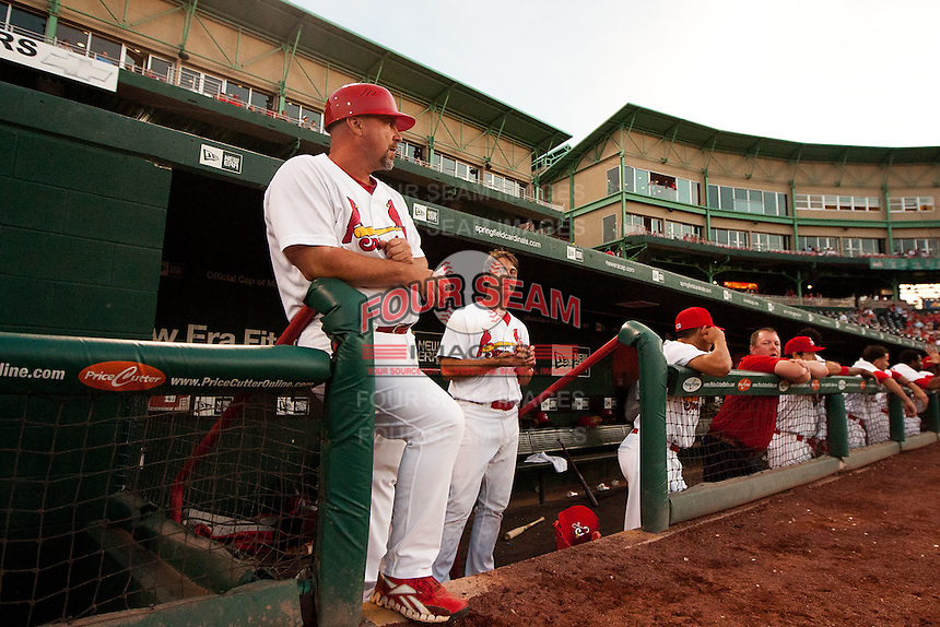 Hitting Coach Phillip Wellman (30) of the Springfield Cardinals stands on the dugout steps during a game against the Arkansas Travelers at Hammons Field on June 13, 2012 in Springfield, Missouri. (David Welker/Four Seam Images)