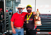 Jul 12, 2020; Clermont, Indiana, USA; NHRA top fuel driver Billy Torrence (right) celebrates with son Steve Torrence after winning the E3 Spark Plugs Nationals at Lucas Oil Raceway. This is the first race back for NHRA since the start of the COVID-19 global pandemic. Mandatory Credit: Mark J. Rebilas-USA TODAY Sports