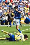 Cruz Azul forward Cesar Delgado jumps over America Aguilas defender Duilio Davino as they fight for the ball during their soccer match at the Azul Stadium in Mexico City, April 15, 2006. America won 3-1 to Cruz Azul... Photo by © Javier Rodriguez
