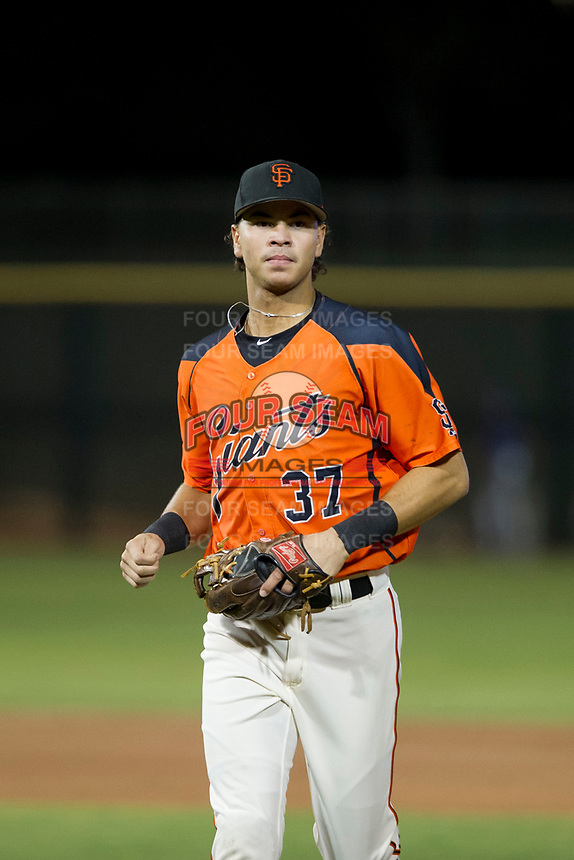 AZL Giants shortstop Francisco Medina (37) jogs off the field between innings of the game against the AZL Cubs on September 5, 2017 at Scottsdale Stadium in Scottsdale, Arizona. AZL Cubs defeated the AZL Giants 10-4 to take a 1-0 lead in the Arizona League Championship Series. (Zachary Lucy/Four Seam Images)