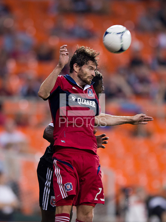 Brandon McDonald (4) of D.C. United goes up for a header with Arne Friedrich (23) of the Chicago Fire at RFK Stadium in Washington, DC.  D.C. United defeated the Chicago Fire, 4-2.