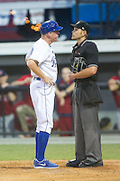 Burlington Royals manager Tommy Shields (19) argues a call with home plate umpire Brock Ballou during the game against the Johnson City Cardinals at Burlington Athletic Park on July 14, 2014 in Burlington, North Carolina.  The Cardinals defeated the Royals 9-4.  (Brian Westerholt/Four Seam Images)