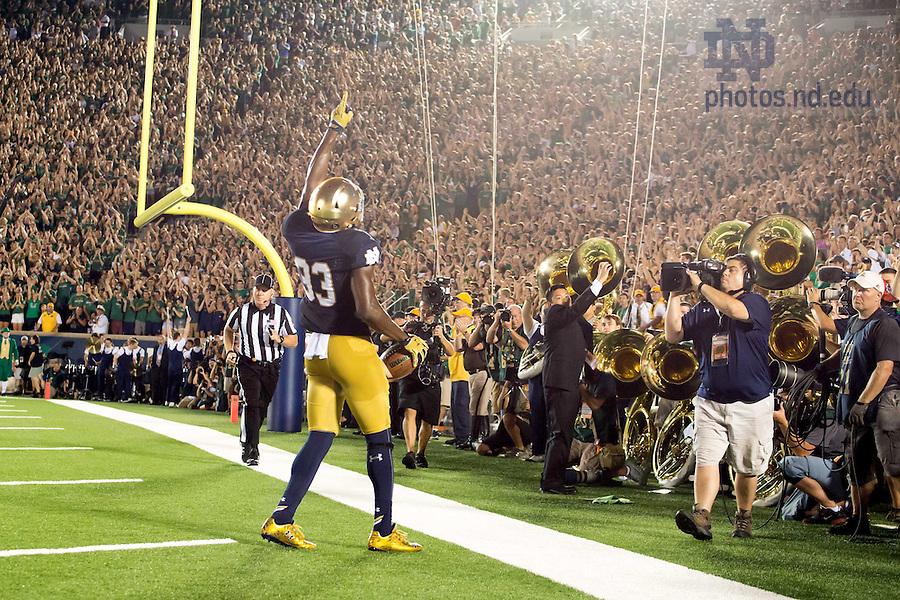 Sept. 5, 2015; Josh Adams (33) celebrates his touchdown. Notre Dame defeated Texas 38-3. (Photo by Matt Cashore)