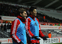 Wednesday, 12 December 2012<br /> Pictured: Angel Rangel and Ki Sung Yueng of Swansea<br /> Re: Capital One Cup, fifth round, Swansea City FC v Middlesbrough at the Liberty Stadium, south Wales.