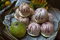 "Yogyakarta, Java, Indonesia.  ""Bali Oranges"", peeled, Beringharjo Market."