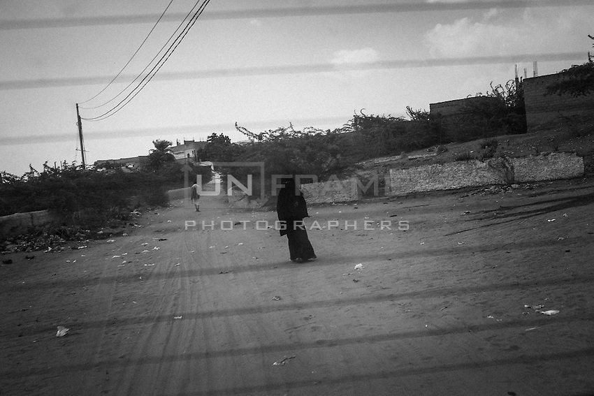 A woman walks on a lane of the sweltering Attorba village, in Bayt al-Faqih district.<br /> <br /> October 9th 2012.