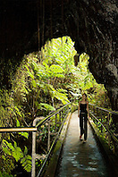 Woman visitor entering Thurston Lava Tube ( Nahuku ), Hawaii Volcanoes National Park, Kilauea, Big Island, Hawaii