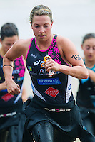 17 SEP 2011 - LA BAULE, FRA - Holly Lawrence (Stade Poitevin Tri) runs to transition at the end of the swim during the final round of the women's French Grand Prix Series at the Triathlon Audencia in La Baule, France (PHOTO (C) NIGEL FARROW)