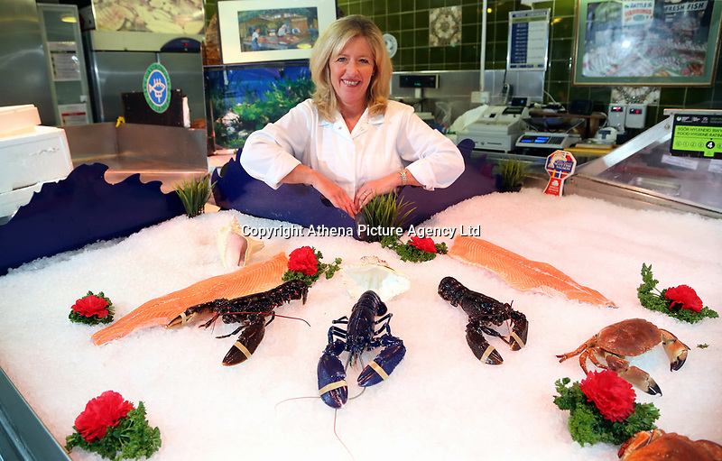 COPY BY TOM BEDFORD<br /> Annabble Denty of Coakley-Greene Fishmongers with the rare blue lobster called Chelsea amongst two black ones, believed to be one in 2,000,000 that was caught off the coast of Scotland, at Coakley Greene fishmongers in the indoor market, Swansea, Wales, UK.