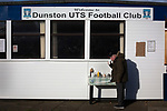 A supporter at the refreshment kiosk at the UTS Stadium before the FA Cup fourth qualifying round match between Dunston UTS and their local rivals Gateshead. Founded in 1975, the home team were formerly known as Dunston Federation. The visitors won 4-0 watched by a record crowd of 2,500.