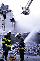 File Photo Montreal (Quebec) CANADA<br /> Fireman at work on OLd-Montreal. No model release<br /> Photo (c) P Roussel / Images Distribution