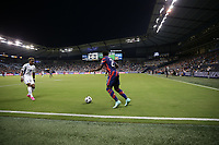 KANSAS CITY, KS - JULY 15: George Bello #21 of the United States moves the ball out of the corner during a game between Martinique and USMNT at Children's Mercy Park on July 15, 2021 in Kansas City, Kansas.