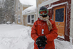 Young man after a snowstorm, Rockport, Maine, USA.