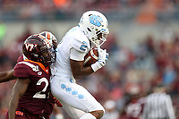BLACKSBURG, VA - OCTOBER 19: Dyami Brown #2 of the University of North Carolina catches the ball while being guarded by Chamarri, Conner #22 of Virginia Tech during a game between North Carolina and Virginia Tech at Lane Stadium on October 19, 2019 in Blacksburg, Virginia.