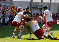 24th April 2021; Brentford Community Stadium, London, England; Gallagher Premiership Rugby, London Irish versus Harlequins; Curtis Rona of London Irish tackled by Jack Kenningham and Wilco Louw of Harlequins