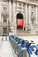 Citi Bike bicycles wait for riders at a docking station near the National Museum of the American Indian.