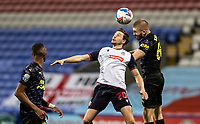 Bolton Wanderers' Shaun Miller (centre) competing with Newcastle United U21's Jude Swailes (right) <br /> <br /> Photographer Andrew Kearns/CameraSport<br /> <br /> EFL Papa John's Trophy - Northern Section - Group C - Bolton Wanderers v Newcastle United U21 - Tuesday 17th November 2020 - University of Bolton Stadium - Bolton<br />  <br /> World Copyright © 2020 CameraSport. All rights reserved. 43 Linden Ave. Countesthorpe. Leicester. England. LE8 5PG - Tel: +44 (0) 116 277 4147 - admin@camerasport.com - www.camerasport.com