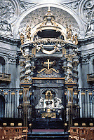 Paris: Val de Grace--high altar. Six columns on an oval plan, each column topped by a giltwood angel. Baldacchino by Bernini. Baroque sculpture. Photo '90
