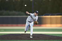 Wake Forest Demon Deacons starting pitcher Ryan Cusick (33) delivers a pitch to the plate against the Louisville Cardinals at David F. Couch Ballpark on March 6, 2020 in  Winston-Salem, North Carolina. The Cardinals defeated the Demon Deacons 4-1. (Brian Westerholt/Four Seam Images)