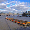 This is a view from Hungerford pedestrian bridge looking east over Waterloo Bridge towards St Paul's Cathedral and the City of London.<br />