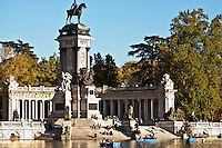 The monument to Alfonso XII sits on top of the stairs overlooking the biggest of the ponds in the park. Is a classical building, with an equestrian statue of the king. retiro Park, Madrid, Spain
