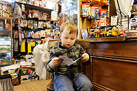 Pictured: A Christmas card received is read by Athur at Hafod Hardware store in Rhayader, mid Wales, UK. Thursday 05 December 2019.<br /> Re: Shop owner Thomas Lewis Jones has made a Christmas advert starring Arthur Lewis Jones, his two-year-old son costing only £100.<br /> Hafod Hardware in Rhayader, Powys, has been making festive adverts for several years.<br /> This year's advert sees Arthur setting up the shop along with members of his family.